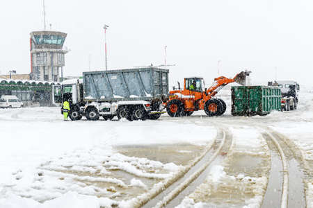 Lugano Agno,  Switzerland - 5 March 2016 - workers who clean the airport runway at Lugano/Agno on Switzerland from the snow 報道画像