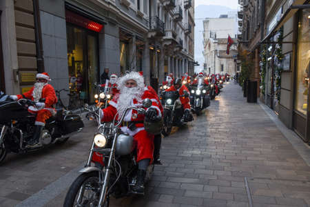 Lugano, Switzerland - 3 December 2016: Christmas parade of Santa Clauses who drive a motorcycle on the streets of Lugano on the italian part of Switzerland