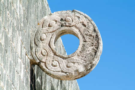Famous Stone Ring located 9 m above the floor of the Great Ball Court. Chichen Itza archaeological site, Yucatan, Mexico