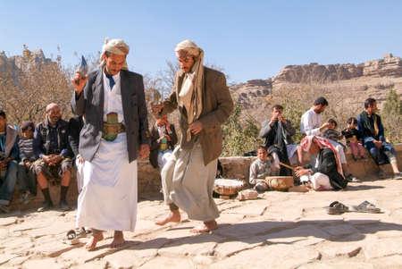 Wadi Dhahr, Yemen - 4 January 2008: two men dancing the traditional yemeni dance with jambiya dagger
