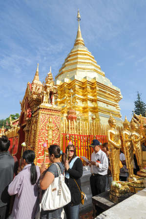 believers: Chiang Mai, Thailand - 8 January 2016: belivers praying at the Wat Phra That Doi Suthep temple of Chiang Mai, Thailand