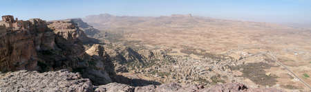 suq: Red rocks and decorated old houses, overview of Shibam valley seen from Kawkaban on Yemen