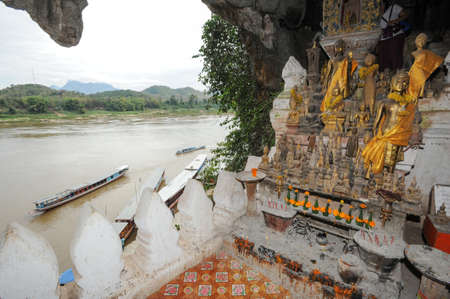 Buddha statues of Pak Ou caves in Luang Prabang, Laos Editorial