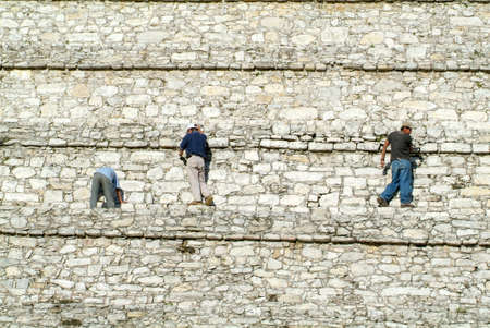 Palenque, Mexico - 22 January 2009: people who restore the wall of the pyramid at Palenque on Chiapas in Mexico