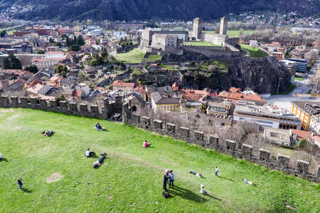 Bellinzona, Switzerland - 19 March 2017: people walking on the walls of Montebello castle at Bellinzona on the Swiss alps Redakční