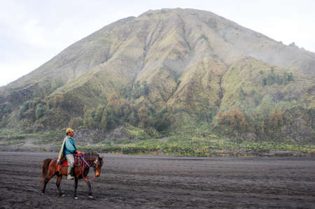 Bromo, Indonesia - 4 february 2013: horse rider on Mt.Bromo national park, Indonesia