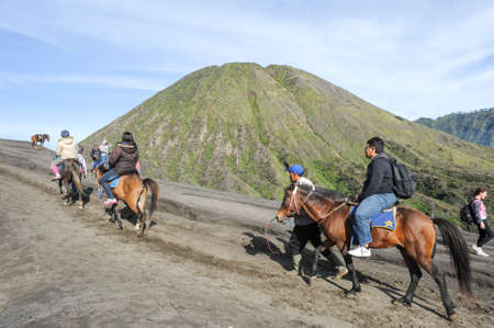 Bromo, Indonesia - 4 february 2013: tourists horse rider on Mt.Bromo national park, Indonesia