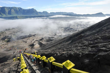 Bromo, Indonesia - 4 february 2013: People climbing the steps leading up to Mt Bromo volcano in Java, Indonesia. Editorial