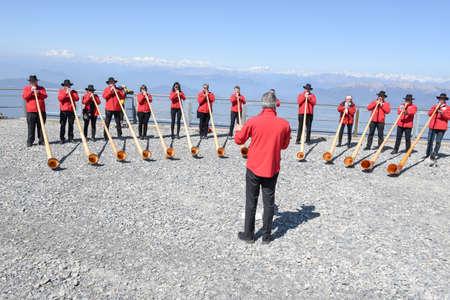 alphorn: Mount Generoso, Switzerland - 8 April 2017: People playing the alphorn at Mount Generoso on the Swiss alps