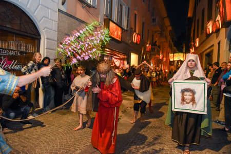 adoration: Mendrisio, Switzerland - 13 April 2017: annual procession of the crucifixion of Jesus Christ at easter in Mendrisio on Switzerland