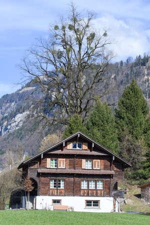 Wolfenschissen, Switzerland - 5 March 2017: chalet in the countryside of Wolfenschissen on the Swiss alps