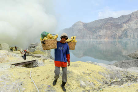 the miners: Vulcano Ijen, Indonesia - 5 February 2013: Miners with their sulfur crops climb the ijen crater on the island of Java, Indonesia Editorial