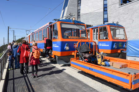 Monte Generoso, Switzerland - 8 April 2017: Tourists in the rack train that reaches the summit of Mount Generoso on the Swiss alps Editorial
