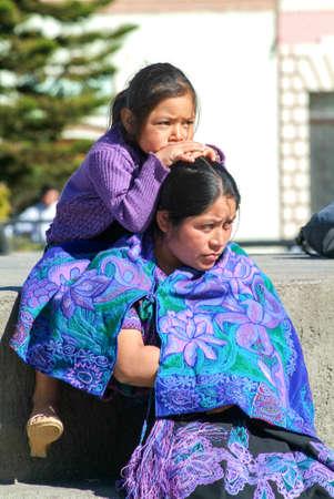 Cristobal de las Casas, Mexico - 19 January 2009: maya woman with her daughter at San Cristobal de las Casas on Chiapas, Mexico Editorial