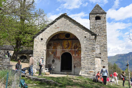 oratoria: Sementina, Switzerland - 17 April 2017: the romanesque church of St. Bernard in the chestnut on Mornera at Sementina on the Swiss alps