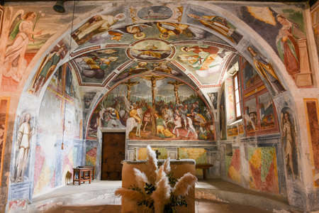 Sementina, Switzerland - 17 April 2017: the paintings of the romanesque church of St. Bernard at Sementina on the Swiss alps