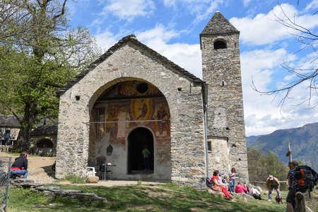 Sementina, Switzerland - 17 April 2017: the romanesque church of St. Bernard in the chestnut on Mornera at Sementina on the Swiss alps