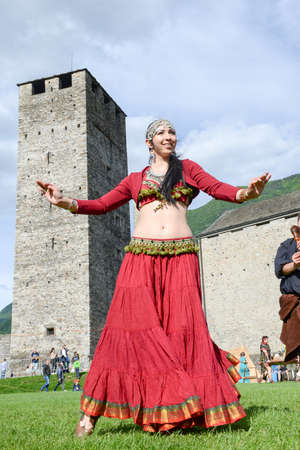 sexy girl dance: Bellinzona, Switzerland - 21 May 2017: Medieval music group featuring a belly dancer at Castelgrande castle at Bellinzona on the Swiss alps