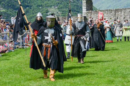 historical events: Bellinzona, Switzerland - 21 May 2017: people walking during a parade of medieval characters on Castelgrande castle at Bellinzona on the Swiss alps Editorial