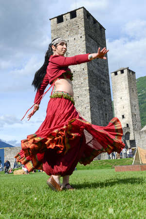 Bellinzona, Switzerland - 21 May 2017: a belly dancer at Castelgrande castle at Bellinzona on the Swiss alps Stock Photo - 80069786