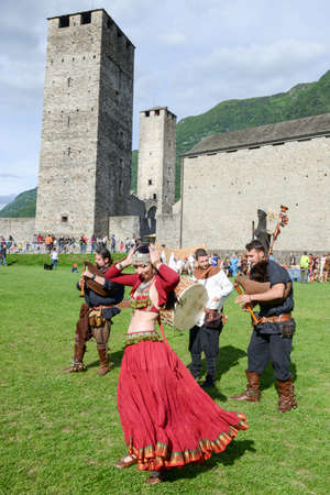 Bellinzona, Switzerland - 21 May 2017: Medieval music group featuring a belly dancer at Castelgrande castle at Bellinzona on the Swiss alps