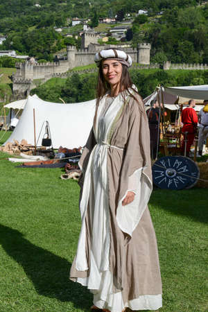 antiques: Bellinzona, Switzerland - 21 May 2017:  beautiful woman at the medieval market on Castelgrande castle at Bellinzona on the Swiss alps
