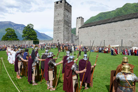 legends: Bellinzona, Switzerland - 21 May 2017: people during a parade of medieval characters on Castelgrande castle at Bellinzona on the Swiss alps