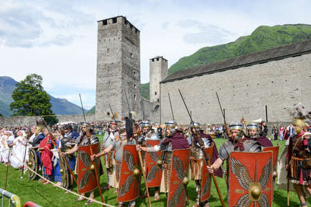 Bellinzona, Switzerland - 21 May 2017: people during a parade of medieval characters on Castelgrande castle at Bellinzona on the Swiss alps