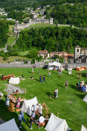 antiques: Bellinzona, Switzerland - 21 May 2017: people walking and shopping at the medieval market on Castelgrande castle at Bellinzona on the Swiss alps