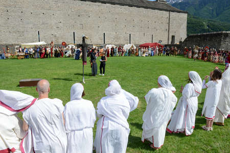 historical events: Bellinzona, Switzerland - 21 May 2017: people during a parade of medieval characters on Castelgrande castle at Bellinzona on the Swiss alps