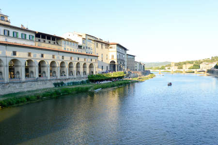 river arno: Firenze, Italy - 5 July 2017: people sailing with a boat on river Arno at Florence on Italy.