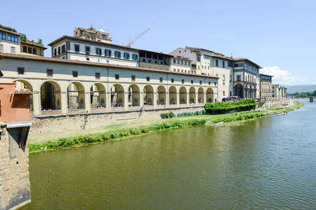 Firenze, Italy - 5 July 2017: river Arno and Uffizi museum at Florence on Italy.