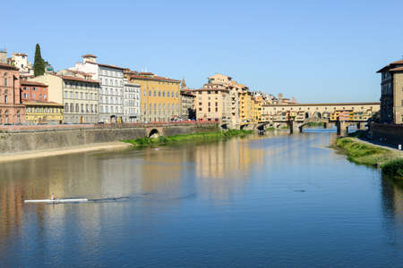 Firenze, Italy - 5 July 2017: man rowing a boat on river Arno at Florence on Italy. Editorial