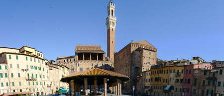 Siena, Italy - 7 July 2017: market square and Mangia tower at Siena, Italy Editorial