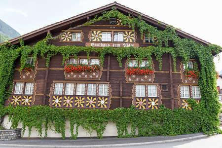 church flower: Burglen, Switzerland - 3 August 2017: the typical chalet at Burglen on canton Uri in the Swiss alps Editorial