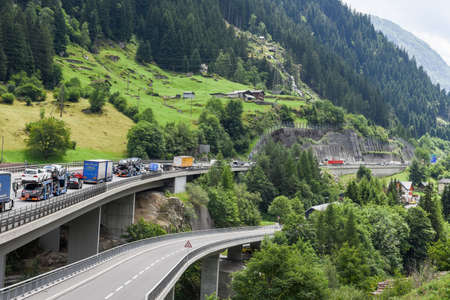 Goesschenen, Switzerland - 12 July 2017: vehicles on highway waiting in line for entering Gotthard tunnel on the Swiss alps Editorial