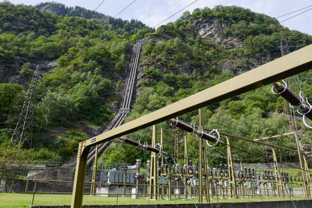 Power station making Electricity from a hydroelectric plant on leventina valley in the Swiss alps Stock Photo