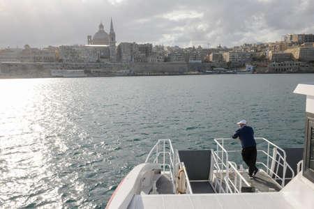 La Valletta, Malta - 31 October 2017: man on the ferry leading to La Valletta on Malta