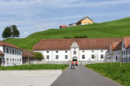Einsedeln, Switzerland - People walking in front of Einsiedeln Abbey on Switzerland Banque d'images