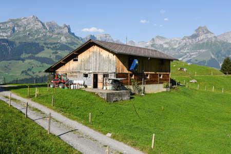 Engelberg, Switzerland - 2 August 2017: farmhouse over Engelberg on the Swiss alps