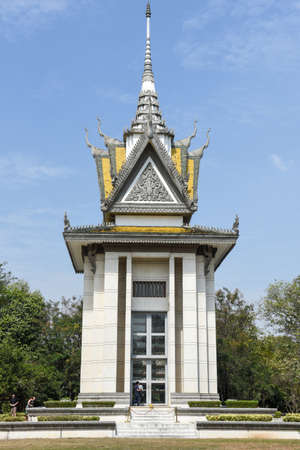 The memorial stupa of the Choeung Ek killing fields, containing some of the Khmer Rouge victims remains. Near Phnom Penh, Cambodia Stock Photo