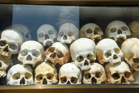 The skulls of torture victims resting in a stupa at the Killing Fields outside of Phnom Penh, Cambodia.