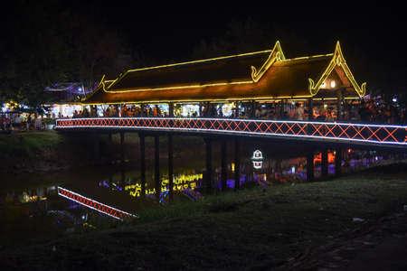 Siem Reap, Cambodia - 10 january 2018: Illuminated bridge and night market in Siem Reap, Cambodia