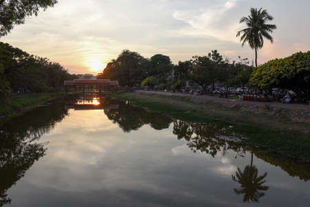 Siem Reap, Cambodia - 10 january 2018: river with bridge and night market in Siem Reap, Cambodia