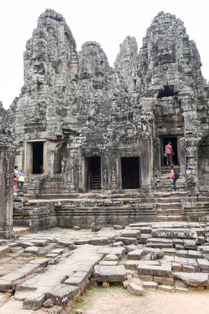 Siem Reap, Cambodia - 10 January 2018: people visiting on walking Bayon temple at Siem Reap in Cambodia. Banco de Imagens