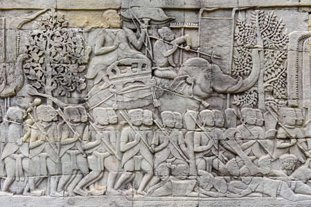 Bas relief sculpture, elephant charging into battle between the Cham and Khmer. Bayon Temple, Angkor Thom, Siem Reap, Cambodia