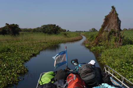 Tonle Sap lake, Cambodia - 13 January 2018: tourist boat navigating a tributary river to the Tonle Sap lake in Cambodia Editorial