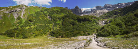 River with water from the glacier of mount Titlis over Engelberg on the Swiss alps 免版税图像