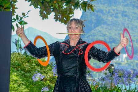 Lugano, Switzerland - 17 July 2016 - juggler Gaby Schmutz of Duo Full House at Buskers Festival in Lugano, Switzerland
