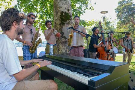 Lugano, Switzerland - 17 July 2016 - Dr. Kolzen & the Sbronzerband playing live at Buskers Festival in Lugano, Switzerland Editorial